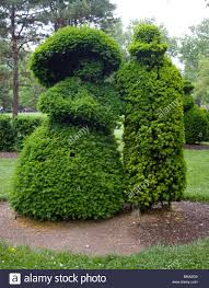 Columbus Topiary Garden - french topiary couple sculpted out of bushes in a park in columbus