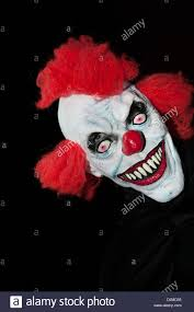 halloween scary background a scary halloween clown mask against a black background stock