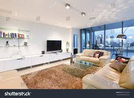 Homeview Design Inc by Living Room Books Near Television Comfortable Stock Photo