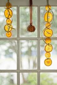 learn how to make this garland with dried oranges bay leaves and