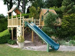 great use of a slope half treehouse half play ground tree