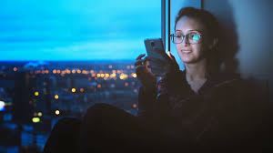 Hipster Lights Young Woman Texting On Smartphone On Night City Lights Background
