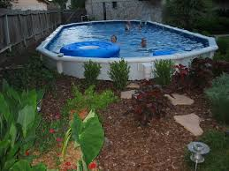 landscape ideas for backyard around above ground pool decorating