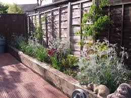 raised garden beds against fence customized corners protect raised