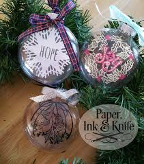 ornament with floating papercut inside paper ink and