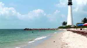 biscayne bay lighthouse on a beautiful day surrounded by palm