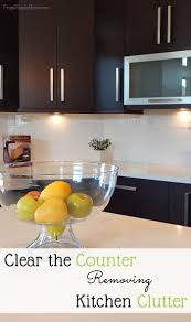 clear the counter removing kitchen clutter