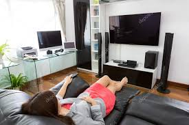 home office with tv business young woman watching tv in modern home office with comp