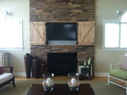 Kitchen Tvs by Hidden Tv Over Fireplace And Tvs On Pinterest Arafen