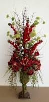 red hydrangea with ranunculus arrangement designed by arcadia