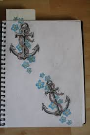 barbed anchor and small flowers tattoos page tattooshunter com