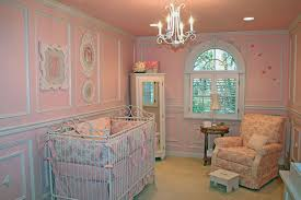 bedroom tiny baby nursery chandelier above casual carpet and nice