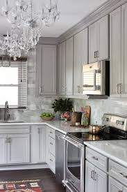 how to paint kitchen cabinets a burst of beautiful gray kitchen features gray raised panel cabinets paired with viatera