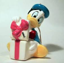 donald duck with gift disney ornament from our schmid bros