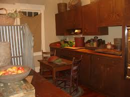 small primitive kitchen ideas 6833 baytownkitchen astounding small primitive kitchen ideas with cream wall decor amusing small kitchen with traditional wooden cabinet and dining set
