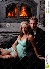 romantic couple fireplace roaring royalty free stock image image