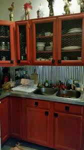 A Little Barnwood Kitchen Cabinets And Corrugated Steel Backsplash - Cabin kitchen cabinets