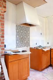 a cement tile backsplash in the kitchen