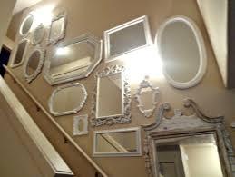 100 mirrored walls yellow walls curved sofa wood mantel