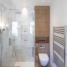 blooming towel rack above toilet with small bathrooms shower