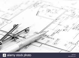 house building construction plans with calculator pencil and