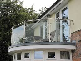 glass door wall outdoor and patio crisscross white iron balcony railing and