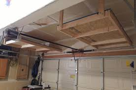 Garage Storage Building Plans by Backyards Shelves Over The Garage Door Cavender Diary Img 4473