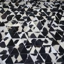 Black And White Floor Rug Artful Floor Rug Crafted In Cowhide Mark Tuckey Designerrug Rug
