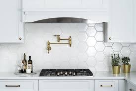 white kitchen cabinets with hexagon backsplash classic white hexagon backsplash rookwood tile hexagon