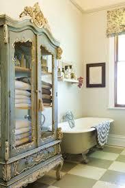 lovely shabby chic bathroom decor idea with small chandelier above