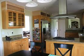 recycled countertops extending kitchen cabinets to ceiling