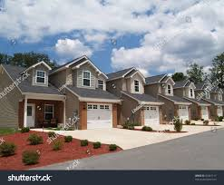 two story low income retirement homes stock photo 54361117 two story low income retirement homes with the garage in the front