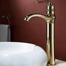 dark red wall color with antique gold sink faucet for cozy