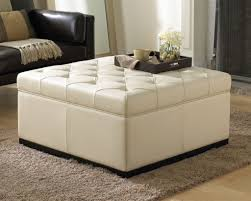 living room with white tufted square storage ottoman useful and