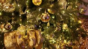 Gold And Brown Christmas Tree Decorations by A Christmas Tree Decorated With Golden Glitter Christmas Tree Ball