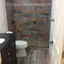 we installed slate tiles with mosaic shower base and weathered