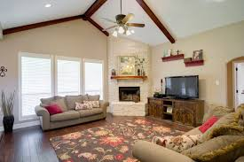 corner fireplace vaulted ceiling recessed lighting and hand