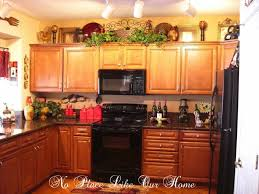 ideas for on top of kitchen cabinets kitchen 17 best ideas about decorating above kitchen cabinets on
