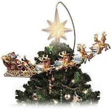 increase the with a magical animated tree topper the santa