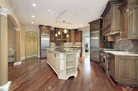 kitchen in new construction home with l shaped island stock photo