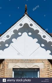 looking up at the gable of an old fashioned house with elegant