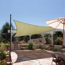 patio with l shaped trellis and rectangle shade sail outdoor