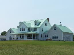 drexel standing seam roof patina green on white clap board and