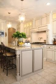 Ivory Colored Kitchen Cabinets - antique ivory kitchen cabinets with black brown granite