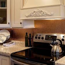wooden island with stainless steel countertop copper backspalsh full size kitchen white granite countertop copper backspalsh electric range and vent hood wallmounted