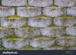 cinder block retaining wall green moss stock photo 383327188