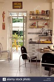 Retro Style Kitchen Table Black Metal Chairs At Table Set For Breakfast In Retro Style