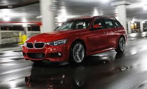bmw 328i xdrive vs audi a4 quattro 2014 audi allroad quattro vs 2014 bmw 328i xdrive sports wagon