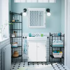 tall narrow shelving unit beside fabulous white bathroom vanity