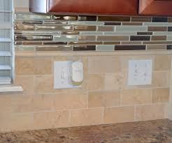 cashmere creme white granite countertop outlets in the backsplash
